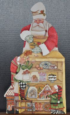 Cooking Santa Front painted on wood.