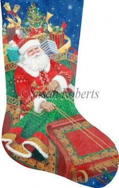 "Santa's On His Way stocking painted canvas by Susan Roberts, Artwork by Liz Goodrick Dillon Size: 12.75"" x 21"" Mesh Count: 18"