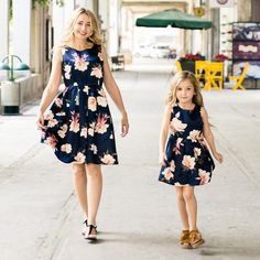 Check out my new Vintage Floral Printed Sleeveless Pleated Dress in Navy  for Mom and Me 3bd86b5a9e5e