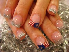 4th of July - don't like the silver glitter - but I do like the middle finger nail design.