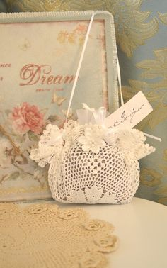 A Lavender Sachet  |  Made from a crocheted doily. She filled the center w/ potpourri, ran a ribbon around the outside,  and pulled tight. Embellished w/ a satin flower that can be purchased at the craft store. Gift for her sister.  //  ♡ I LIKE THE FACT THAT IT LOOKS LIKE A LITTLE PURSE! ♥A