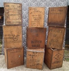 ten vintage tea chests, all with writing relating to tea production ...