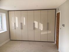 A 7-door wardrobe with mussel doors, tobacco infills.  Long key bar handles.