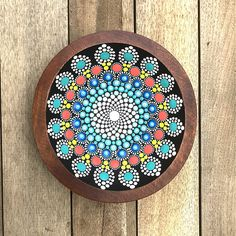 This vintage wood bowl has a hand painted dot mandala pattern inside in shades of teal, blue, bright deep orange and yellow dots. The colors are very rich and very vibrant! This design is made entirely from hand painted colorful dots.... dot by dot!  The bowl measures approximately 6 x 6.  I hand paint each dot with multiple layers giving the observer a treat visually with stunning color as well as a texture for a sensory experience. I love finding vintage solid wood bowls and repurposing…