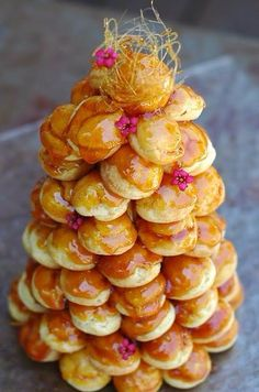 Profiteroles stacked together with caramel!