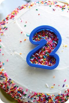 use a cookie cutter for sprinkle shapes on top of frosted cakes. Letters numbers hearts stars. You can also lightly press the cutter, then remove, and write on the cake following your 'guidelines' . Decorate birthday toddler kid party milestone