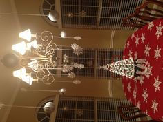 Hang ornaments and snowflakes from the ceiling and chandelier. #HSN #StJude