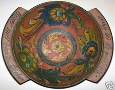 An antique piece painted in the Hallingdal style.
