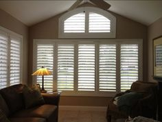 Beautiful arched shutter installation by Budget Blinds of Portland