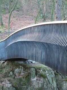 Ornamental footbridge in mild steel and oak