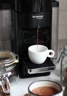 Once you experience a frothy morning cup of coffee, you'll know that this VertuoLine espresso maker from Nespresso is a kitchen essential. Whether you prefer to enjoy a piping hot glass of espresso upon waking up, or savoring your favorite Grand Cru in the evening after dinner, this machine is sure to be put to good use!