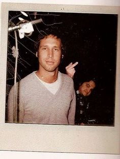 Look how cute Chevy Chase was. That's John Belushi flippin the bird. :D