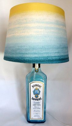 Such a pretty aqua color -- BOMBAY SAPPHIRE Gin recycled bottle lamp -- only $25 on Etsy!