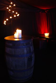 Barrel poseur tables, spiral floor-standing candelabra, candle clusters, black cube furniture, wall uplighters in red by www.stressfreehire.com