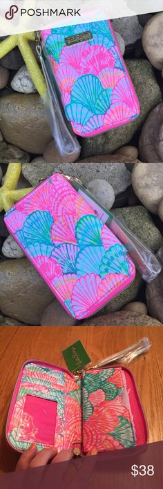 NWT Lilly Pulitzer Wristlet/Wallet NWT Lilly Pulitzer Wristlet/Wallet. Love this ! Oh Shello tiki palm. Fits IPhone 6. Gold tone hardware. Strap is detachable. Zipper closure. 3 credit card slots &1 clear slot for ID. Compartment for bills. Compartment for phone. Colors of shells are bright pink, white, turquoise/sea foam & hints of a orange/ coral color. NO TRADES. Lilly Pulitzer Bags Clutches & Wristlets