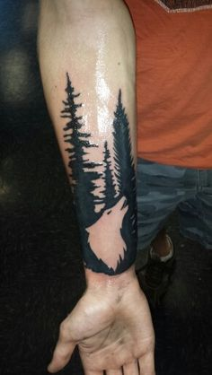 My first tattoo, wolf and trees