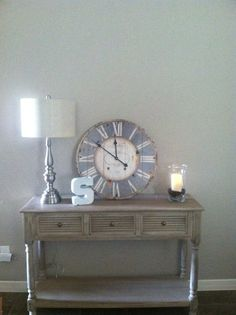 Console table- Hobby Lobby  Lamp- Hobby Lobby Clock-Kirklands  The S sign- Marshalls  And a vanilla candle with coffee beans