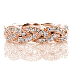 Legato - Created of seamlessly intertwining elements the Legato is elegantly braided with micro pavé diamonds. Each segment is edged with milgrain texture along the woven pattern adding dimension to the crisscross design. This unique woven band can be worn as a wedding band or a fashion ring.