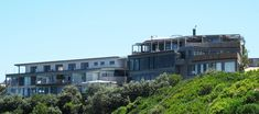 Enjoy panoramic views of the ocean, Wilderness Lake and Fynbos Reserve from a comfortable environment at Wilderness Beach Resort in Wilderness. Beach Resorts, Wilderness, South Africa, Multi Story Building, Environment, Ocean, Mansions, House Styles, Into The Wild