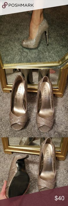 Guess sparkly silver heels Brand new! Size 6.5 guess heels open toe. Silver glittery amazing in person! Excellent condition just sat in my closet Guess Shoes Heels