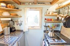 LOVE this kitchen... and the house. For an 8x20 they really made use of the space. Check out the loft... loving the height of the ceiling. Plus: If they just de-cluttered throughout, they would really have an open floor plan.
