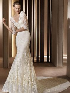 2013 lace wedding dress (I love lace. I want sleeves and lace and a deep back. Why won't any pictures show the back?)