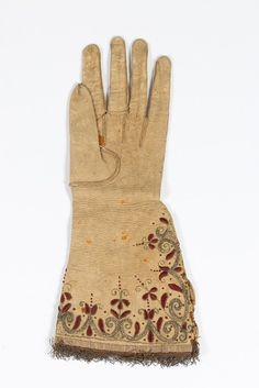 Single Embroidered Glove (image 2) | 1630-1640 | leather, silk | Kerry Taylor Auctions | December 8, 2015 | Believed to have belonged to King Charles I. Legend states this glove was used to wrap the garter badge the day of King Charles' execution.