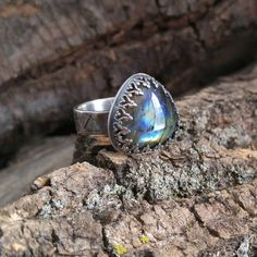 Blue Flash Labradorite and Sterling Silver Ring. Ornate Bezel Setting. Wide Hammered Cross Stamped Band. Rainbow Colored Flash. Size 7 1/2 by QuietTimeJewelry on Etsy