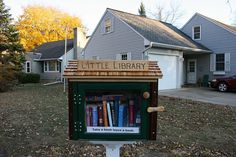 "A recently-opened Little Free Library. What a lovely thing to do with all my ""once read"" books. I absolutely love this idea!"