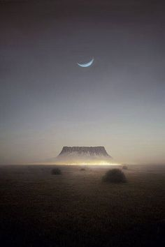 Crescent moon over Ayers Rock.