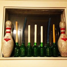 Old Candles, old bowling pins and old green glass bottles created this little display in one of my windows.