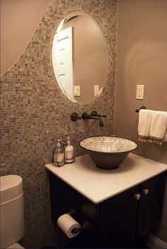 I like how the mirror seems to be a part of the wall. The only thing I don't like it the tile inside of the sink bowl.