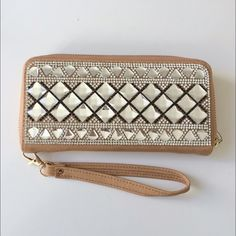 """Light brown bling wristlet/ wallet Light brown bling wristlet/ wallet Measures: 8"""" long/ 4"""" tall NWT. Sent in original packaging. The inside has two billfolds, eight card slots, and one zippered pouch. Zipper closure. Strap can be removed (not shown in photo, but it's included!) Available in red, black, blue, and brown.  Availability- 2 Price is firm unless bundled. No trades Boutique Bags Clutches & Wristlets"""