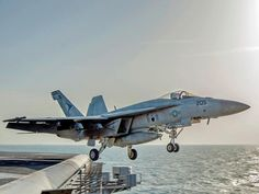 This image released by the U.S. Navy on Friday, Dec. 5, 2014, a F-18 fighter jet launches from the flight deck of the Nimitz-class aircraft carrier USS Carl Vinson (CVN 70) as the ship conducts flight operations in the U.S. 5th Fleet area of operations supporting Operation Inherent Resolve targeting ISIS militants in Iraq and Syria.