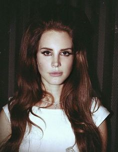 Lana Del Rey red hair bouffant cross necklace Born to Die era