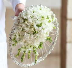 A cartwheel circle bouquet of white scented stocks and freesia, and a sparkly hoop ~ Angelica Lacarbonara.| Fleuramour