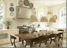 pretty kitchen with dining table and pretty chairs which can double as island / work surface