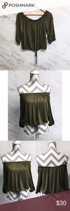 Green off the shoulder top Olive green off the shoulder top with drawstring waist. Slightly cropped fit. Would look great with high waisted bottoms.   •No trades •No holds •Offers & bundles can be made through the offer/bundle tools Tops Blouses