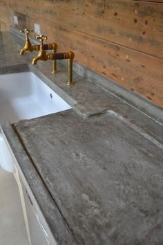 Polished Concrete Worktops  AND those faucets!