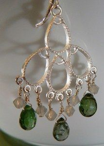 These are fabulous and perfectly ornate.    A finished white silver frosted brass chandelier hangs from a leverback earring. It measures nearly 2 inches. On each earring there are three dark green Tourmaline Pear stones and six milky white Swarovski element bicone crystals.