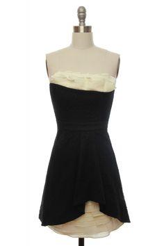 dramatic black textured dress with peek-a-boo ruffles. $79.