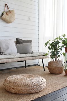 These little rattan ottomans are cheap at IKEA! They can be stacked up to make a little end table or higher seat or you can scatter them for floor seating. The basket with the plant is also from IKEA (Fljadis Basket (spelling? Ikea Outdoor, Outdoor Patio Rugs, Ikea Patio, Outdoor Living, Sinnerlig Ikea, Rattan Ottoman, Ottomans, Lohals, Houses