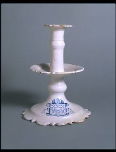 """1648 English Candlestick at the Victoria and Albert Museum, London - From the curators' comments: """"The maker of this object copied its basic form from spun brass candlesticks but added the refinement of shaped edges skillfully cut by hand. As a piece intended for gentle use in a merchant's house, its brittle corners have survived almost intact."""""""