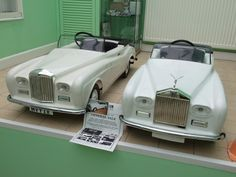 Royal pedal cars.Left to right A special commision from HRH Diana, The Princess of Wales from Tri-ang Sharna PLC of a Bentley convertible (using the same 1960's mould as the RR version next to it here). Rolls-Royce Silver Cloud 111 convertible by Tri-ang Toys Ltd, 1960's.  (Both cars were sold to 'The Cars of the Stars' museum in the USA)