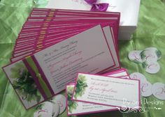 Layered wedding invitations with reply cards and monogram seals. #weddinginvitations #orchids
