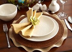 Pier1imports.com  Gold Flutter Placemat • Dark Brown Round Rattan Placemat • Embossed Swirl Dinner & Salad Plates & Pintuck Napkin with Cream Flower Napkin Ring • Wave Flatware • Sitting Bunnies – Small • White Bird Salt & Pepper Set • Embossed Swirl Cereal Bowl
