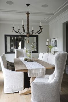 dining room...farm table and slipcovered chairs and terrarium centerpieces