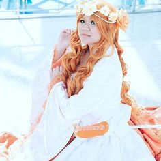 """Loving this photo of my #Goldeen #gijinka by @tukrography  This photo definitely doesn't make me feel like a fish out of water. Thank you so much for the wonderful photo. --- Also I felt like this would also be the perfect photo to give a shout out and huge thanks to the following people for selling amazing products that helped make this cosplay come together. xoxo -jnet --- Custom Unicorn flower crown - @alanawaffles  Autumn Orange Curly Wavy Extra long wig Hera 38"""" - @epiccosplaywigs…"""