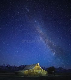 Photo about Crowded sky Milky way moving in the night sky over the Old Mormon Barn in the Tetons. Image of wyoming, astrophotograph, mountains - 86060980 Winter Coming, Portfolio Website, Milky Way, Aurora Borealis, Night Skies, Wyoming, Northern Lights, Old Things, Snow