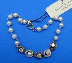 Wear this elegant faux pearl Judith Jack bracelet for added sophistication to your ensemble.